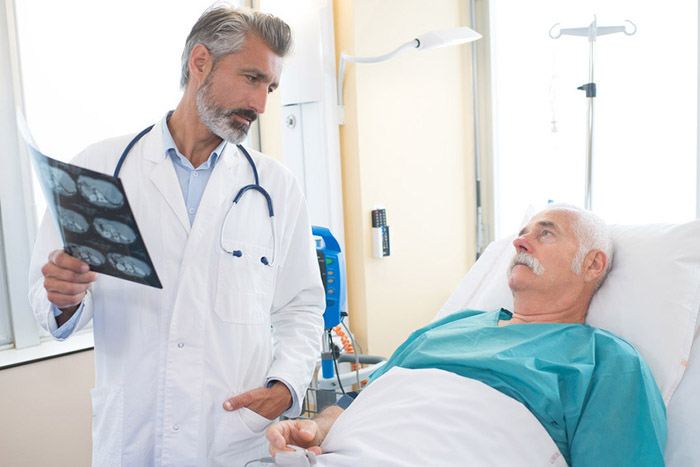 Doctor explaining results of xray to patient